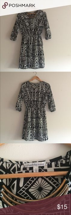Aztec print dress Really cute Aztec black and white dress with gold necklace accessorie sewn on. It has 3/4 length sleeves. Charlotte Russe Dresses Mini