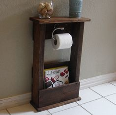 Handcrafted toilet paper holder stand with shelf and storage pocket. The perfect addition to any home bathroom or apartment.  It has been lightly sanded down, then stained and sealed with a beautiful dark walnut finish. Non-marking, non-skid rubber pads are installed on the bottom of the base. This piece does not include the accessory items as shown in the pictures.  The color of the stained wood captured in the photos might vary slightly.  Measurement Notes: The height selected is the…