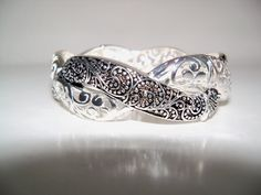 Today's Bella Baubles Special... the pretty... Silver Marcasite/Twisted Filigree Bracelet... regular price... $12.99... today... only... $10.99!  funjewelz.com