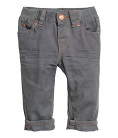 5-pocket pants in cotton twill. Ribbing and adjustable elastication at waist, and zip fly with snap fastener.
