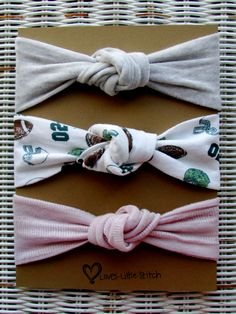 This is a set of 3 (three) adorable top knot baby headbands. Perfect for a baby girl who loves football!! The headbands are unique and the