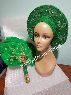 Nigerian aso-oke made into auto gele. Silver color, beaded and stoned. Party ready in less than 5 minutes. One size fit, easy adjustment at the back. Purchase this gele with the green feather hand fan or without. African Print Fashion, African Fashion Dresses, African Dress, Nigerian Lace Styles, African Lace Styles, Feather Bouquet, Hand Fans For Wedding, African Jewelry, African Fabric