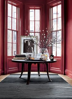 Windows painted in an elegant red paint, Ralph Lauren's Townhouse, a part of their Greenwich Village Collection.