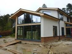Image result for contempory bungalow with glass entrance