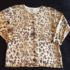 "Shimmering leopard cardigan Nice lightweight layering cardigan in leopard print with shimmering silver sparkles in the fabric and jeweled buttons, oh so girly, will fit up to 38"" bust, length is 24.5"", rayon, polyester metallic blend Macy's Sweaters Cardigans"