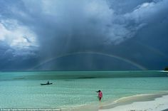 Winner: Into the Green Zone, by George Tapan, captured a rainbow after the rain at the Palawan Islands in the Philippines, winning the category of Places