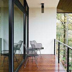 Perfect indoors and out, our wire chairs add charming mid-century style to this modern home design recently featured in #Dwell Magazine. #wirechair #outdoors #midcentury #takeitoutside #RejuveSpotted