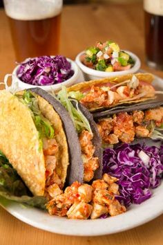 Blue and yellow corn taco shells filled with spicy chicken, cheddar cheese, tomatoes and lettuce. Served with mango salsa and shredded red cabbage.
