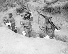 THE KOREAN WAR 1950 - 1953 Soldiers from the 1st Battalion, The Essex Regiment in cold weather gear carrying the components of a Vickers machine gun.