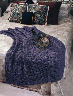 """Comfy Afghan:Finished Size: 47"""" x 58"""" MATERIALS: Worsted Weight Yarn: 44 ounces, (3,015 yards) 29"""" Circular knitting needles, size 17 or size needed for gauge Note: Afghan is worked holding two strands of yarn together."""