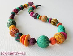 Tarot necklace 02 by Boxes for Groxes | Flickr - Photo Sharing!  Love the bright colors she uses