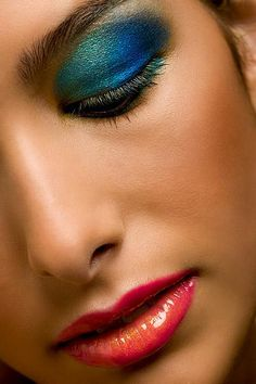 Teal and blue eyeshadow pink and gold lips