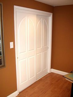An idea for the laundry room if we stack washer and dryer. These pocket doors don't need to go into wall, just behind one another