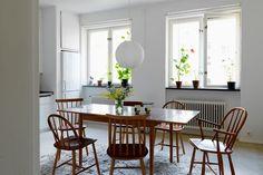 window ledge, chairs, rugs, plants