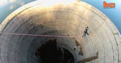 Slacklining over a 200ft deep drain! http://outsidetelevision.com/video/daredevil-slackliner-crosses-200ft-deep-reservoir-drain