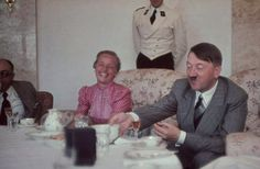 Tea time. Hitler was quite affable in his relaxed moments. Here, he shares a joke with a lady who obviously appreciates his humor. Partially visible on the left is Dr Morell, Hitler's charlatan doctor.