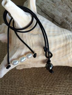 A personal favorite from my Etsy shop https://www.etsy.com/listing/239736580/rice-pearl-choker-style-necklace-leather