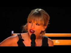 """Taylor Swift performs a live acoustic version of """"Red"""" with Alison Krauss, Vince Gill, Sam Bush, Edgar Meyer, and Eric Darken in a collaboration segment during the 47th Annual CMA Awards at Bridgestone Arena in Nashville, TN. Aired Wednesday, November 6, 2013 8-11pm ET on ABC"""