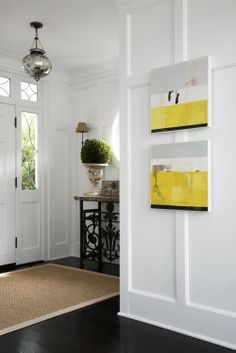 Looove love love these crisp white walls, sharp black floors, and the pop of our signature Tinsel yellow
