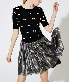 Adoring this metallic skirt with pleats!