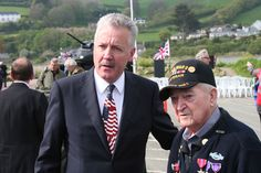 Edward Sobczyk being honored for his saving lives in WWII Operation Tiger, Slapton Sands England with John Casson