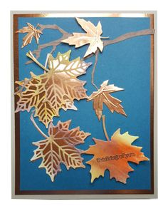 handmade greeting card  .... die cut Autumn maple leaves ... solid layer cut from copper foil ... lacy veins cut from paper colored in Fall colors ... luv the contrast betwee the shiny copper ad the denim blue background ... sentement heat embossed on die cut leaf cut from colored paper ... lovely arrangement of leaves and branches ...  from Wild Wing Creations ... Stampin' Up!
