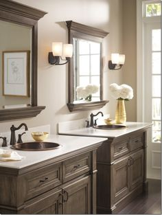 If you love dark, woods, this gray toned pair of cabinets are certainly eye catching.