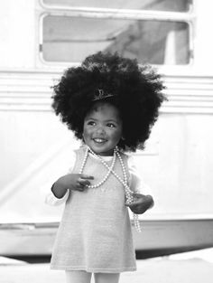 she will rock her fro if she gets grandma and her dad's hair! I am i will turn her onto palmer's coconut oil . . . ;)