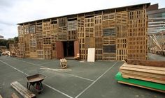 """Junkitecture - LOVE that word!  """"Borrowed"""" it from this website... esibuilding.wordpress.com  -  this huge building is being constructed using wood shipping pallets."""