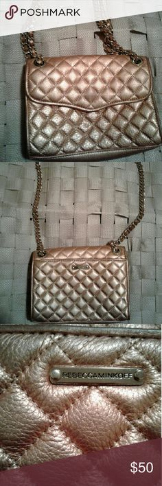 Rebecca Minkoff Quilted Rose Gold  crossbody Leather Crossbody in rose gold. Leather straps around the chain has a cut, but not noticeable. Can wear 2 different ways. Has been worn but free of stains. Minimal loss of shine on the front wear the where the magnetic closure is. No stains or holes. Beautiful color. With just enough space to stash your must-haves (lip gloss, cell phone, wallet, keys, and sunglasses), this compact style makes a seamless transition from day to night. Rebecca…
