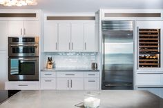 This custom kitchen features concrete countertops, custom cabinets, and other beautiful touches.