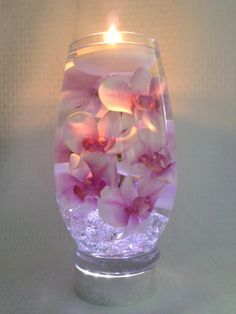 Decoration: Pink orchids with purple centers float in a 12 inch glass vase filled with water perfect for wedding reception centerpieces or home decor Wedding Reception Centerpieces, Vase Centerpieces, Wedding Table, Wedding Decorations, Vases, Wedding Bouquets, Centerpiece Ideas, Wedding Receptions, Wedding Flowers
