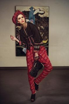 Timorese-design Thai silk jacket, black Lycra tube top and Timorese-design obi by Ghea Panggabean. Striped Thai silk harem pants by Carmanita. Bow Wire Bag by ANTEPRIMA. Velvet peeptoe clogs by Aldo. Red row silk ornamented headwear by Deden Siswanto.