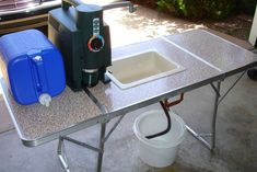 (Pop up camper) Outdoor sink made out of folding table