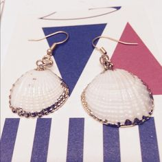 Seashell clam earrings Handmade from baby clam shells gorgeous dangly beach earrings trimmed with 14k gold filigree and polished up for a completely classic beach girl style. Happy shopping! Handmade Jewelry Earrings
