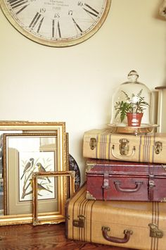 Vintage suitcases with a cloche in a antique silver serving tray.