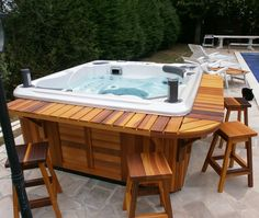 A Hydropool Self-Cleaning hot tub with a custom made cedar bar to go with the standard cedar cabinet!