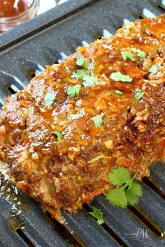 Mexican Meatloaf recipe is a tasty twist on a classic. This hearty meatloaf recipe uses spicy flavors of cumin, cilantro, green chiles and chorizo.