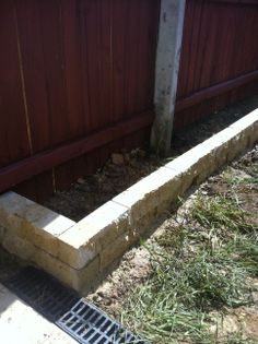 www.pavingcanberra.com Retaining Wall: Terraced 2 levels 400mm high Retaing Wall Product: Treated pine. Edging: 2 blocks high. Split face block Edging Product: Concrete blocks. 400mm x 90mm x 90mm Sandstone Landscaping Retaining Walls, Small Backyard Landscaping, Synthetic Lawn, Pool Coping, Concrete Blocks, Garden Boxes, Raised Garden Beds, Outdoor Entertaining, Garden Tips