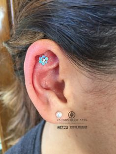 These anatometal flowers are quite the hit with our clients. Gloria stopped by for a helix piercing and instantly fell in love with this piece. 18k rose gold, light blue opals and a CZ center accent. Thank you, Gloria! vaughnbodyarts