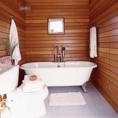 Real Simple: Use cedar panels in lieu of tile in a bathroom to simplify construction and save energy. | CoastalLiving.com