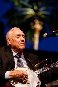 Earl Scruggs, whose banjo-picking technique changed the way people play the instrument, Scruggs, seen here performing onstage in Califonia. Scruggs invented his three-finger style as a child in North Carolina.