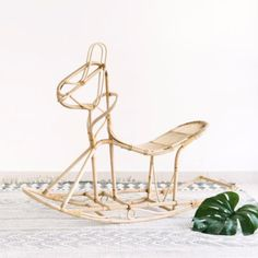 Reminiscent of our youth, this 70's inspired, iconic vintage rattan rocking horse just makes us smile.  Sturdy, yet also elegant, this beautifully hand crafted statement piece will make your kids smile too and bring them endless fun and joy. A stunning addition to a nursery or children's bedroom or a wonderful and unique gift for any parent.