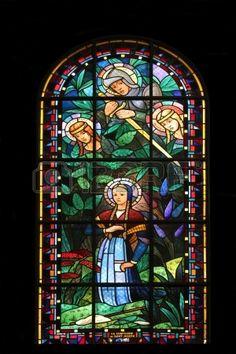 Saint Catherine, Saint Michael, Saint Margaret and Joan of Arc, stained glass, Notre Dame de Clignancourt church, Paris, France