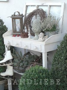 DISPLAY :: Prop an old window up against the back of a small potting table or other table to create dimension for your display.
