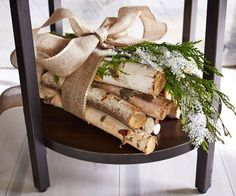 birch log bundle w/ burlap bow and evergreens