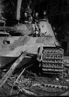 Tiger II out of action, which makes something for children to play on toward the end of the war, 1945.