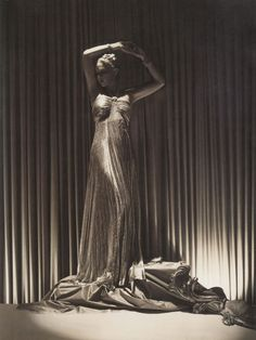 Madeleine Vionnet popularized (though some say she invented) the bias cut gown, which is a technique of cutting the cloth for clothing to utilize the diagonal direction of the cloth, which causes the overall dress to drape more beautifully. This is more expensive as it uses more fabric.