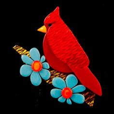 Ruby the Red Cardinal Pin:Ruby the Red Cardinal looks so elegant against the flowers on her little perch. This red bird is amongst blue and orange flowers and a brown tree branch all in multi layer resin. The brooch has a bar pin back and measures approximately 2 inches wide and 2 inches long. Comes in a darling Erstwilder gift box! (Ruby does not... $26.00