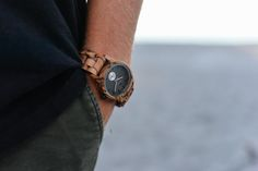 This Tense unisex watch with a wood case and leather strap shows hour, minute, and second markers on a round dial. This Hampton Leather Watch has a dial made from 100% recycled wood. All Tense Watch p